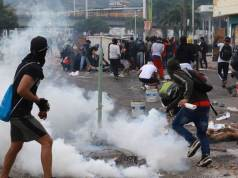 Police kill 10 during protest against Colombian government