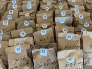 Doha.. Qatari youth serving meals to Afghan refugees