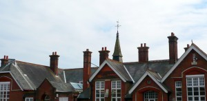 Queen Anne style tall stacks - red brick - perforated ridge tiles. Yum.