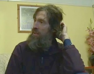 Stephen Gough pictured  clothed and at home