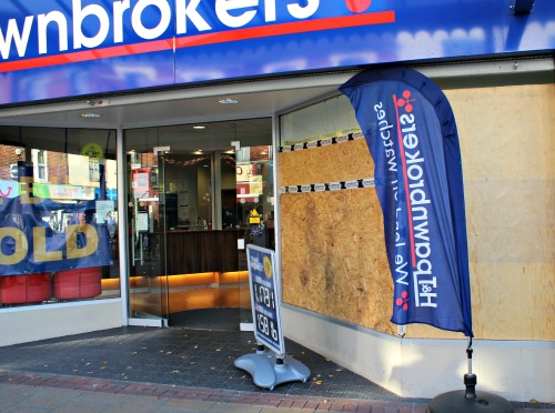 Damaged window at pawnbrokers today