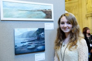 Emily Singleton with her picture [bottom], entitled Beach Scene