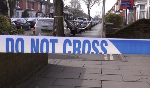 Police line do not cross tape at murder scene
