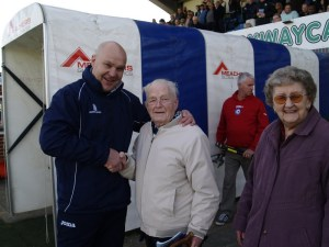 An elated Richard Hill shows appreciation to club founder Derik Brooks (photo by Tony Smtih)