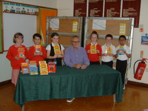 Freegrgounds Junior School Pupils with their books that have been signed by Jeremy Strong (centre)