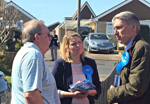 Phil Hammond (R) speaking to residents in Hedge End with Mims Davies