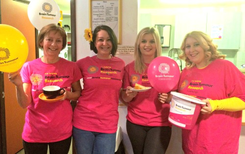 Sophie (right) and colleagues prepare for their Host for Hope event for Brain Tumour Research