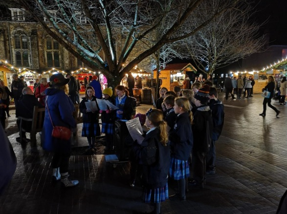 Local pupils spread Christmas cheer at Winchester Christmas Market