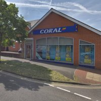 Police charge man over betting shop robberies
