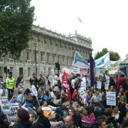 Demonstrators sit down outside Whitehall. Photo: James Masters