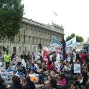 Demonstrators sit down outside Whitehall. Photo: James Masters