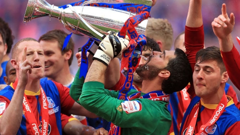 Speroni drinks from the trophy of success. Pic:npower Championship League website
