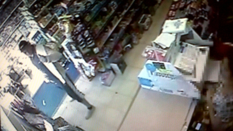 A still from CCTV showing Stuart Hazell buying alcohol and searching for his alleged murder victim Tia Sharp shown to the Old Bailey jury May 10
