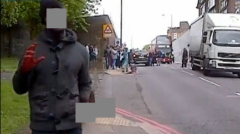 Still from ITV news footage of man at the scene of the Woolwich killing. Pic: ITV News