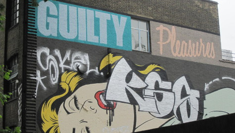 A graffiti has been sprayed over the momental mural only a few days after it has been unveiled