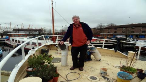 man on boat 2 pic: Brit Dawson