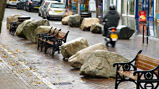 The boulders were  placed by the council in 2012 to prevent parking on the central parade. Photo: Standard website
