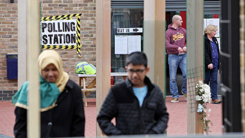 Voters Leave a polling station in Tower Hamlets Pic: Tower Hamlets Council