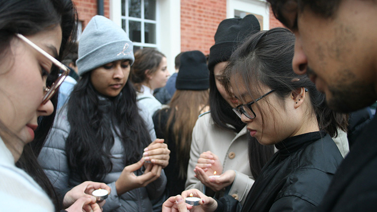 Students light candles at the protest. Pic Amalia Illgner