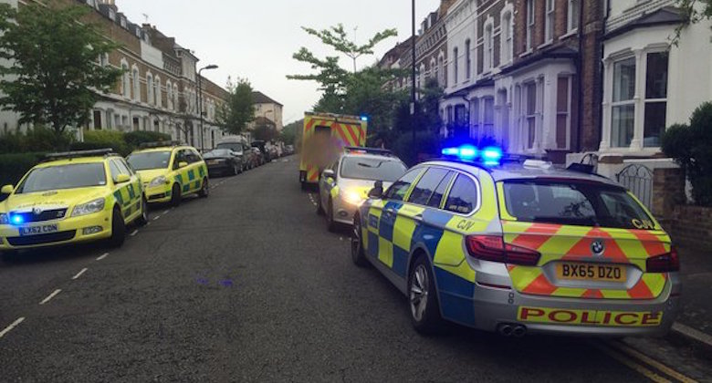 Police officers at the scene in Stoke Newington. Pic: @MPSHackney