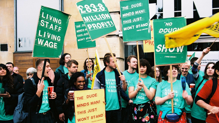Hackney Picturehouse strikers stand with placards for their living wage campaign.