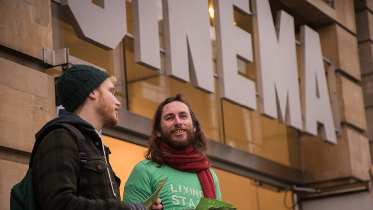 Staff representative Alisdair Cairns hands out leaflets outside the cinema together with another striker