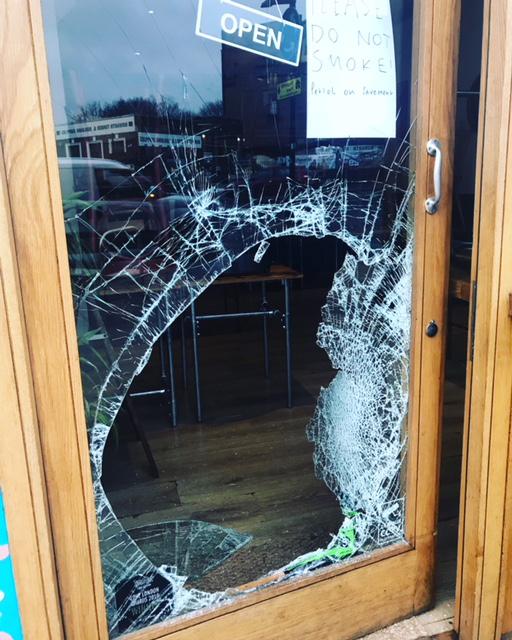 Vandalised door of Masala Wala Cafe