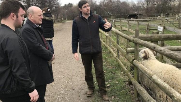 Animal care apprentice Louie Legon with Mayor John Biggs and Mudchute farm manager Tom Davis.