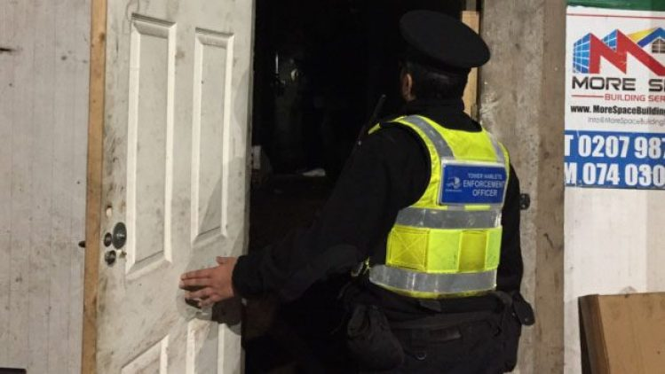 Officers move in the illegal traders' shack after detecting smell of peanuts being roasted.