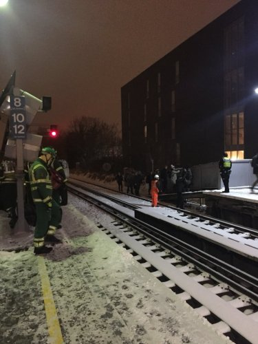 Emergency services helping passengers along the tracks. Pic: Julia Thrift @juliathrift