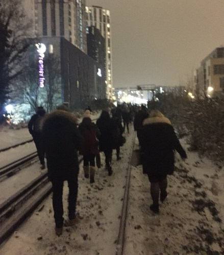Passengers walking along the icy train tracks to Lewisham station. Pic: Julia Thrift @juliathrift
