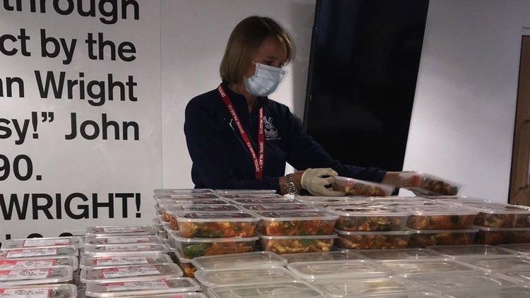 Club staff preparing meals