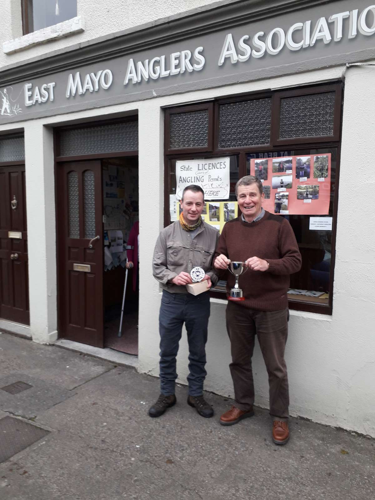 David Hawley, Ballina being presented with the Swinford 250 Perpetual Cup (and 1st prize sponsored by Tiernan Bros. Foxford) by Secretary Paddy McNulty and committee member Michael Tiernan. It is an EMAA initiative to encourage catch and release.