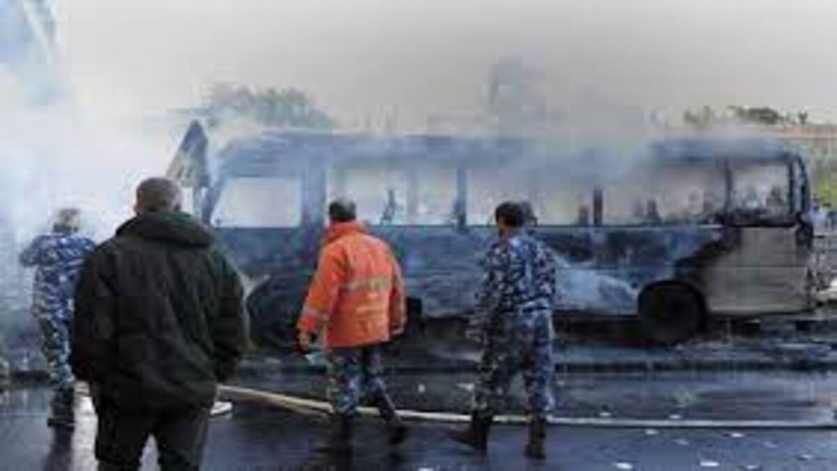 Bomber hit military bus in Syrian capital, killing 14