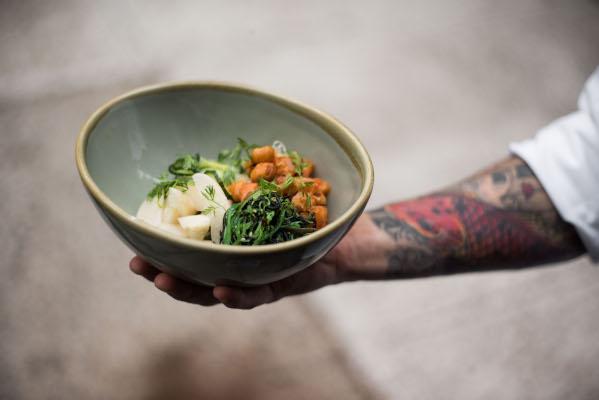 chef arm holding salad