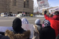 "Flint rally, march call out ""You are welcome here"" and  ""This is what democracy looks like"""