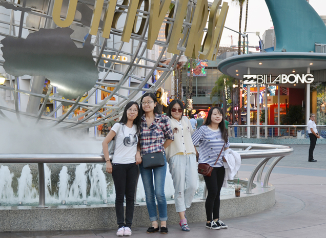 Chinese tourists relax at Universal Studios in Los Angeles' San Fernando Valley