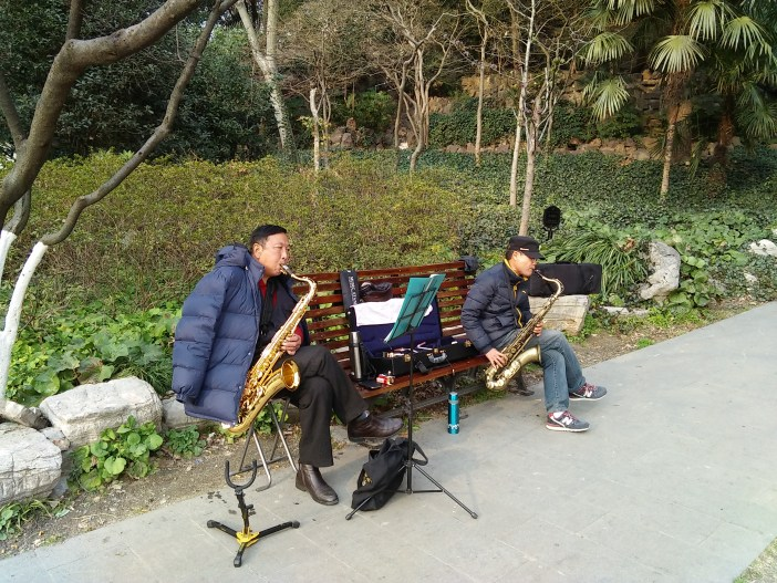 Sax players in Lu Xun park by D Hope