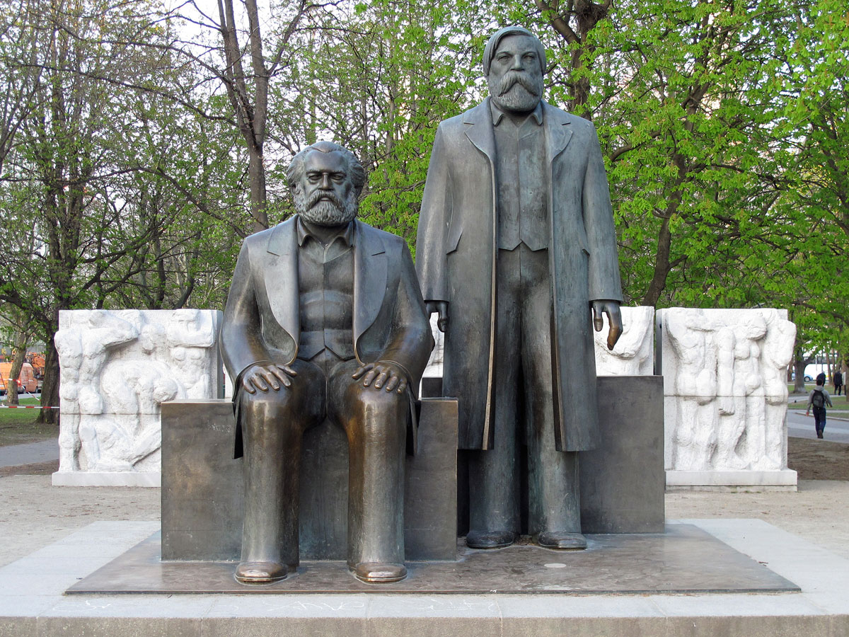 Marx (sitting) and Engels