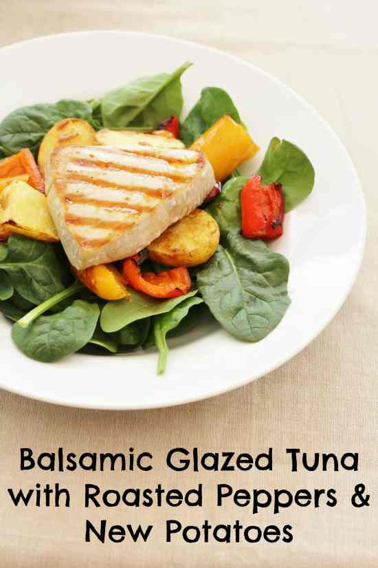 One of the simplest yet most delicious meals I make, Balsamic Glazed Tuna with Roasted Peppers and New Potatoes involves simply roasting red peppers and new potatoes, pan frying tuna steaks and serving it all on a bed of fresh spinach, drizzled with a simple glaze made from balsamic vinegar and olive oil. #tuna #freshtuna #balsamicglaze #roastedpeppers #newpotatoes #easydinners #midweekmeals #easypeasyfoodie
