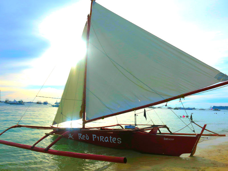 Red Pirates Paraw parked on beach