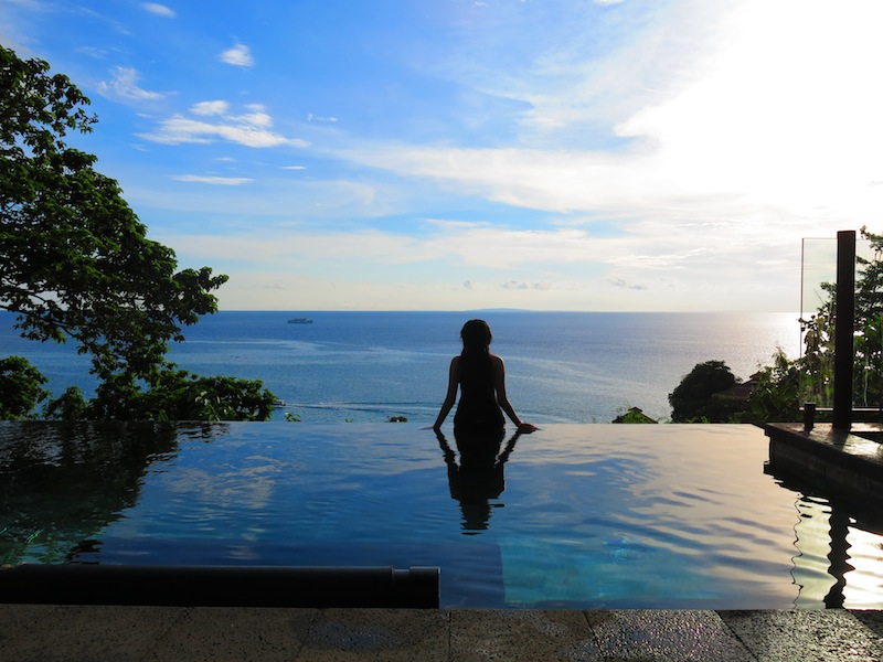 Silhouette of Raevian sitting on edge of Infinity Pool