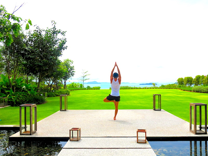 Evan doing yoga pose with beautiful sea view