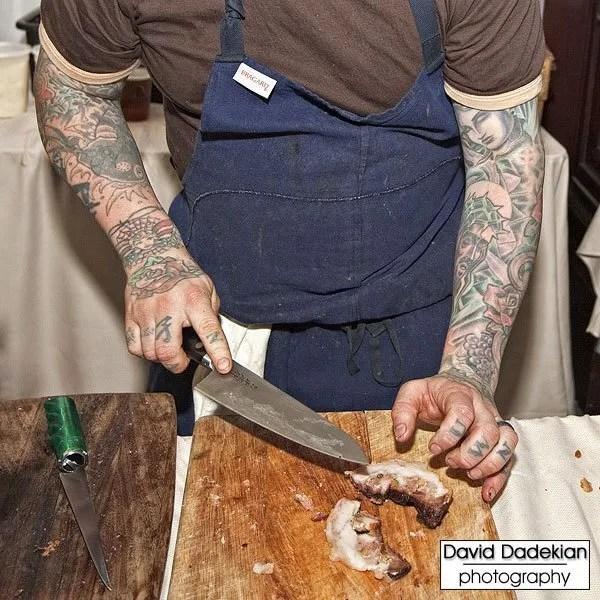 Chef Jamie Bissonnette slicing some porchetta