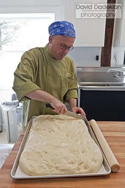 Chef Ciril Hitz demonstrating the preparation of a pastry dough at his home teaching kitchen