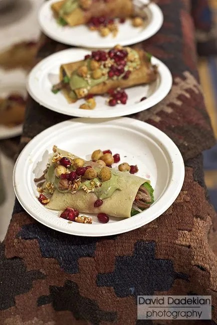Oleana Chef Cassie Piuma's Lebanese Style Lamb Crepe with Harra Sauce, Crushed Walnuts, Cucumber & Pomegranate