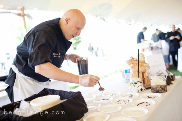 Chef Mike McHugh of Julian's plating his Maple Cured Blackbird Farm Pork Loin, Schartner Farms Rye Biscuit, Chili Creme Fraiche Ice Cream with chocolate balsamic reduction, photo courtesy of Josh Behan www.behanimage.com