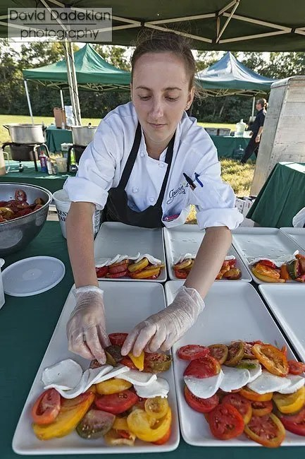 Danielle Lowe plating the heirloom tomato, mozzarella cheese, garden flavors & verjus