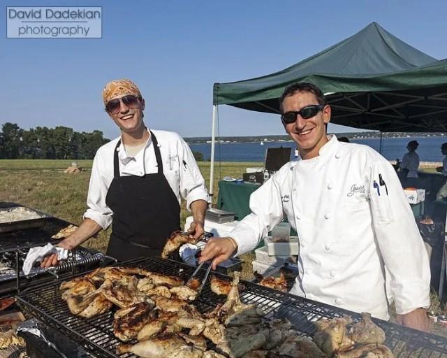 Peter Kachmarsky and Matthew Varga grilling chicken