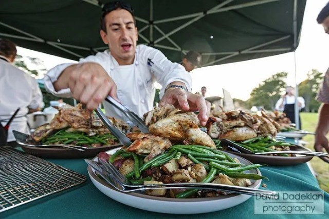 Gracie's Executive Chef Matthew Varga plating rosemary roasted chicken, new crop potatoes, green beans & natural juices